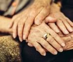 stock-photo-46121606-senior-man-holding-his-wife-s-hand